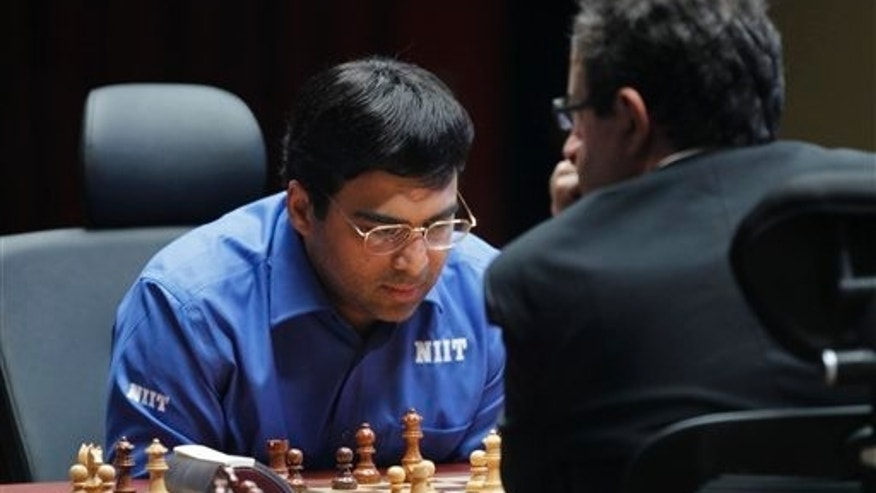 May 30, 2012: World Chess champion Viswanathan Anand from India, contemplates his next move during a match against Boris Gelfand of Israel at the FIDE World Chess Championship tie break match at Moscow's Tretyakovsky State Gallery, Russia.