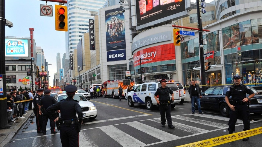 June 2, 2012: Police set up a perimeter outside the Eaton Centre shopping mall in Toronto.