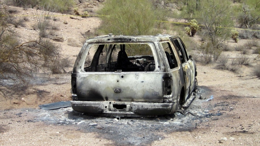 The vehicle where five dead bodies burned  were found inside in Pinal County's Vekol Valley area, west of Casa Grande, N.M. Authorities say the inncident may be drug related. (AP Photo/ Pinal County Sheriffâs Office)