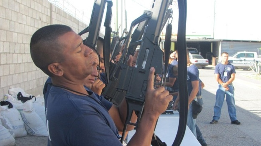 Cadets at the Municipal Police Academy in Ciudad Juárez are trained on the standard issue semi-automatic rifle they will carry on the streets.