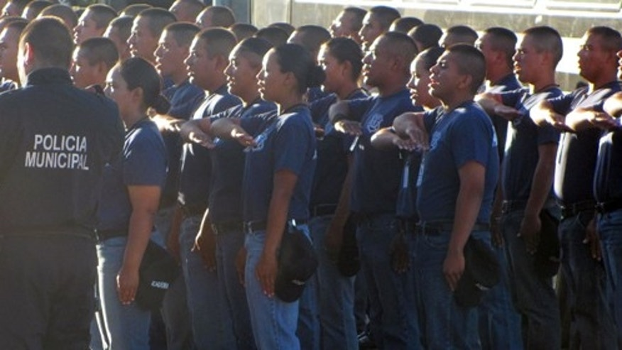 Cadets at the Municipal Police Academy of Ciudad Juárez stand at attention each day for the playing of the Mexican National Anthem.