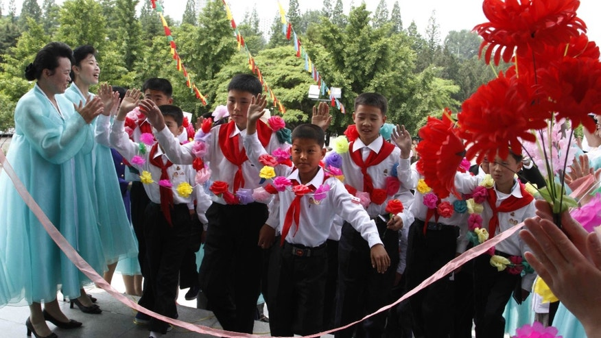June 3, 2012: North Korean students who were selected as delegates to the Korean Children's Union, arrive for lunch at a restaurant in Pyongyang.