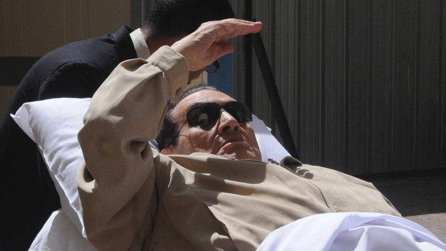 June 2, 2012: Egypt's ex-President Hosni Mubarak lays on a gurney as he arrives at the police academy courthouse in Cairo, Egypt.