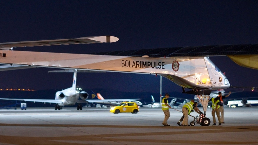 June 5, 2012: The Solar Impulse HB-SIA experimental aircraft is pulled out a hanger at Barajas airport in Madrid, Spain.