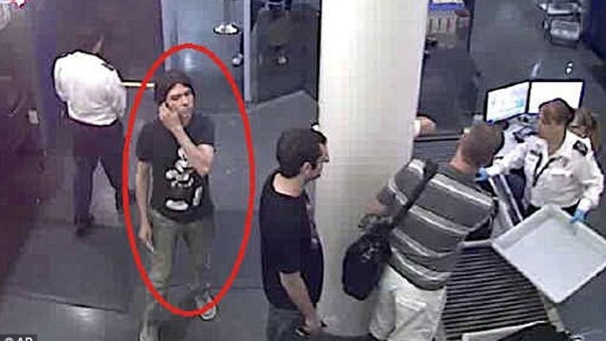 This surveillance image provided by Interpol shows who authorities believe is Luka Rocco Magnotta at a security checkpoint area. A state prosecutor says police are investigating two claimed French capital sightings of the Canadian porn actor wanted in connection with a gruesome murder in Montreal.