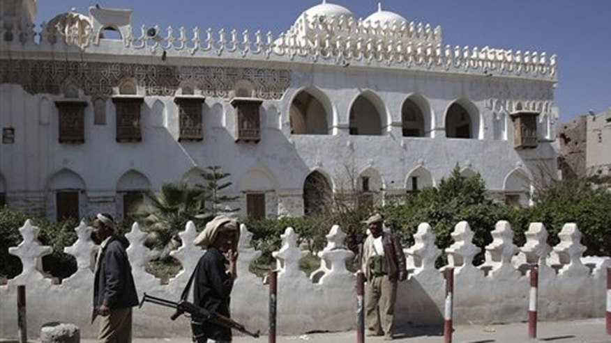 Jan. 25, 2012: Yemeni armed tribesmen stand guard in front of Ameriyah religious school which was seized by Al Qaeda militants in Radda town, 100 miles south of the capital Sanaa, Yemen.
