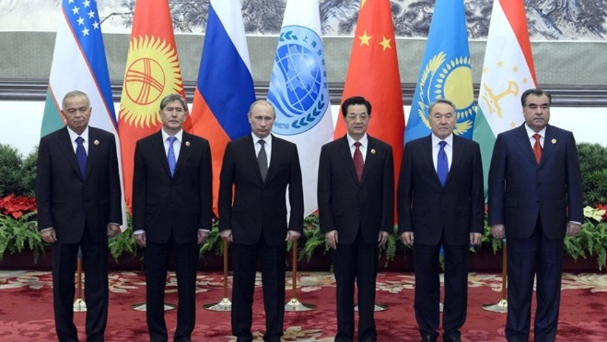 June 6, 2012: Chinese President Hu Jintao, third right, stands with leaders of Central Asian nations, from left, Uzbekistan's President Islam Karimov, Kyrgyzstan's President Almazbek Sharshenovich Atambayev, Russian President Vladimir Putin, Hu, Kazakhstan's President Nursultan Nazarbayev and Tajikistan's President Emomali Rakhmon, for a group photo at the Great Hall of the People in Beijing at the start of the Shanghai Cooperation Organization summit.