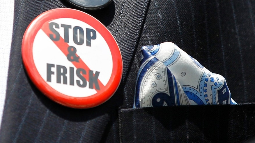 New York City Councilman Jumaane Williams displays several button as he speaks about the New York Police Department's stop and frisk policy, Thursday, June 7, 2012, during a news conference on Capitol Hill in Washington. (AP Photo/Haraz N. Ghanbari)