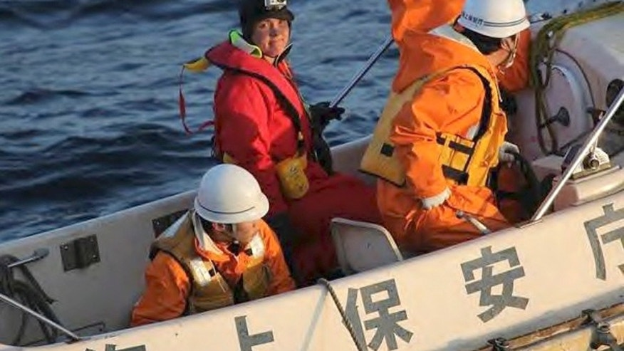 May 8, 2012: In this photo released by Japan Coast Guard, British adventurer Sarah Outen, facing camera, stands in a boat after she was rescued by Japan Coast Guard in the Pacific Ocean off northeastern coast of Japan.