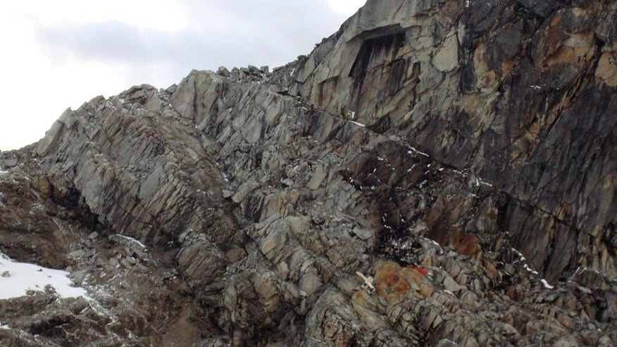 June 9, 2012: On a rocky mountain lays what officials say is debris from the wreckage of a helicopter in the department of Cuzco, Peru.