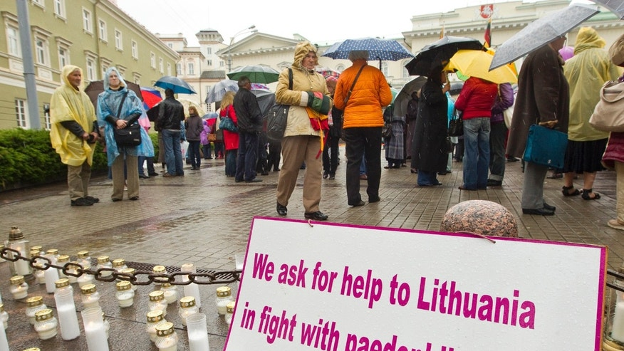 May 17, 2012: Protesters rallying outside the Presidential palace in Vilnius after riot police helped a mother, Laimute Stankunaite regain custody of her now 8-year-old daughter Deimante, in a tragic case that has riveted Lithuania and led to three deaths.
