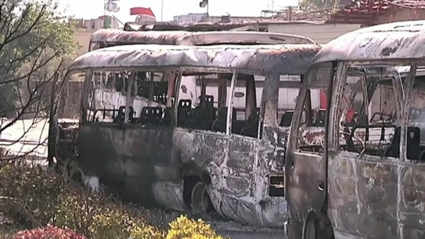 June 9, 2012: This image made from video released by UNSMIS, the UN observer mission in Syria purports to show destroyed buses after overnight fighting in Damascus, Syria.