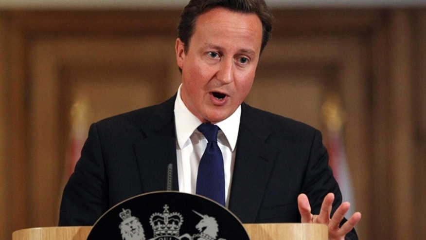 July 8: Prime Minister David Cameron holds a press conference about the phone hacking scandal at Downing Street.