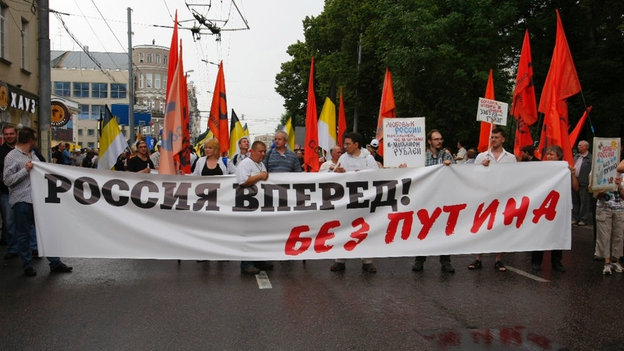 "June 12, 2012: Protesters carry a banner reading, ""Russia Go Forward without Putin"" during a demonstration in Moscow."