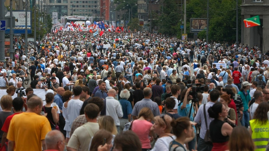 June 12, 2012: People gather during an opposition rally in central Moscow, Russia.
