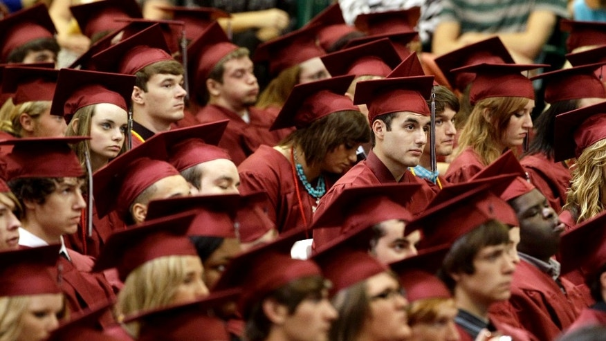 Members of the class of 2012 listen as President Barack Obama delivers the commencement address for Joplin High School Monday, May 21, 2012, in Joplin, Mo. Seniors at the school finished their high school education in a converted big-box store after the old high school was destroyed by an EF-5 tornado that killed 161 people on graduation day a year ago. (AP Photo/Charlie Riedel)