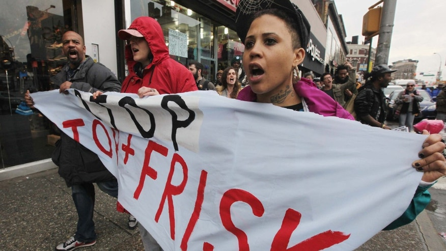 "Opponents of the New York Police Department's controversial ""stop-and-frisk"" policy march."