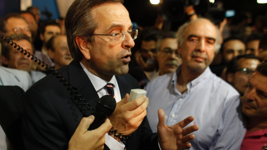 June 17, 2012: Leader of the New Democracy conservative party Antonis Samaras, speaks to supporters at an election stand  at Syntagma square in Athens.