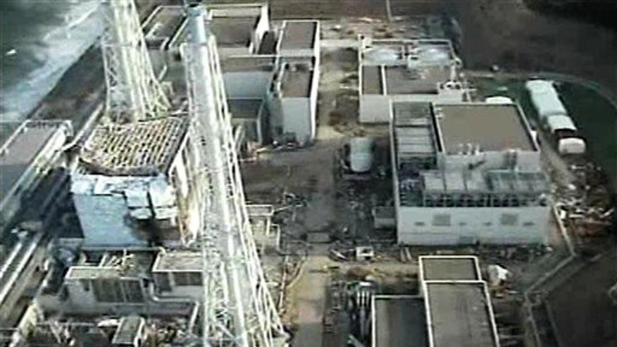 April 10: This image taken by T-Hawk drone aircraft and released by Tokyo Electric Power Co. (TEPCO) shows the damaged reactor building of Unit 4, left, of the tsunami-crippled Fukushima Dai-ichi nuclear power plant in Okuma town, Fukushima Prefecture, northeastern Japan.