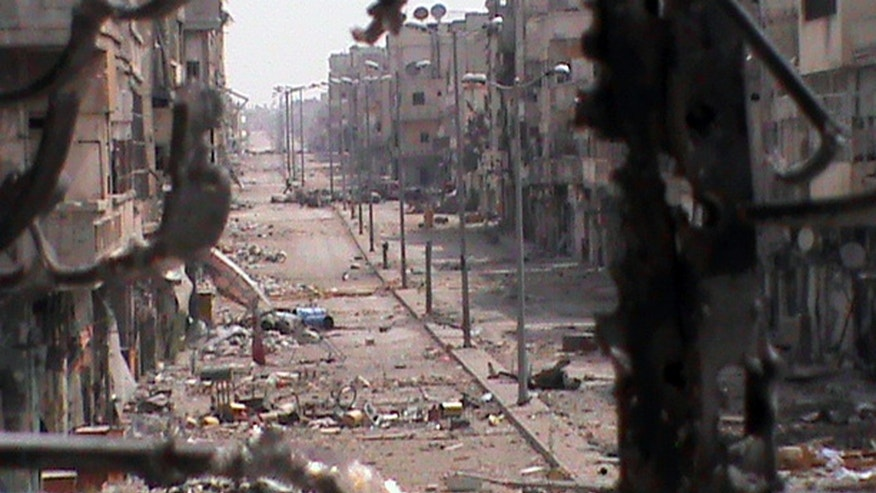 June 21, 2012: This citizen journalism image provided by Shaam News Network SNN  purports to show a general view of a damaged street in the Khaldiyeh neighborhood of Homs province, central Syria.