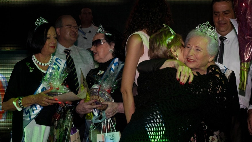 June 28, 2012: Hava Hershkovitz, right, a Holocaust survivor and winner of a beauty pageant is congratulated by another participant, in the northern Israeli city of Haifa.