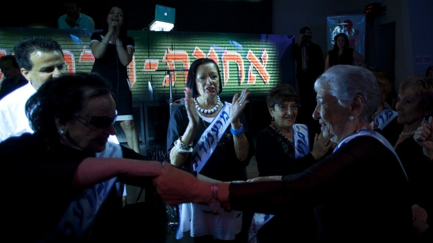 June 28, 2012: Holocaust survivors dance as they participate in a beauty pageant, in the northern Israeli city of Haifa.
