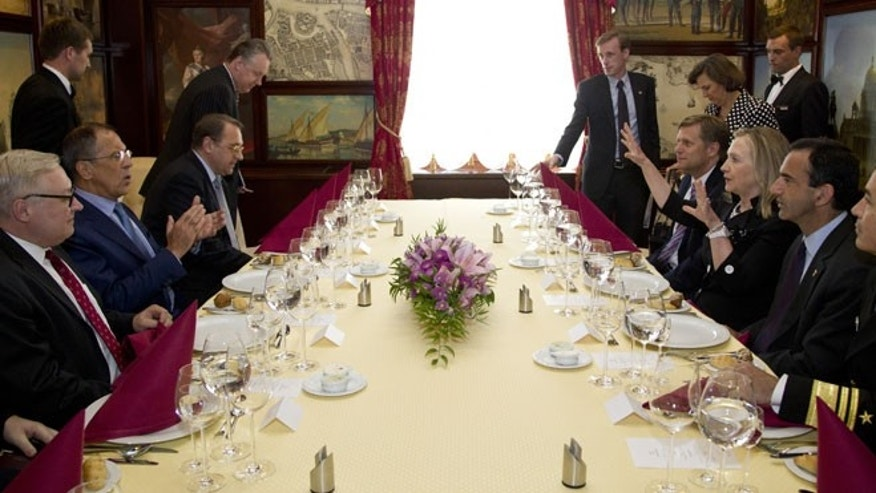 June 29, 2012: Secretary of State Hillary Rodham Clinton, center right, and Russian Foreign Minister Sergey Lavrov, center left, sit down for dinner in St. Petersburg, Russia.