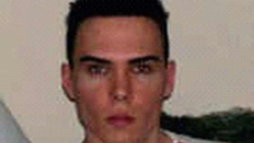 This undated photo provided by City of Montreal Police Service media relations shows Luka Rocco Magnotta, 29, who is wanted for homicide.