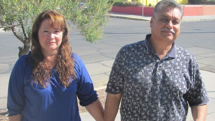José Alfredo Holguín and his wife outside their asylum attorney's office in El Paso, Texas. The couple was forced to flee Ciudad Juárez after extortionists killed their son and threatened the remainder of the family. (Joe Kolb)