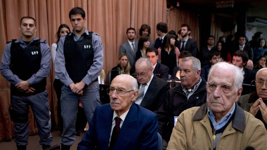 July 5, 2012: Former dictators Jorge Rafael Videla, second from right, and Reynaldo Bignone, right, wait to listen the verdict of Argentina's historic stolen babies trial in Buenos Aires, Argentina.