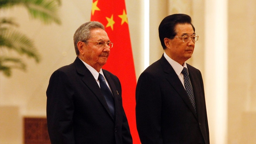 Cuban President Raul Castro, left, and Chinese President Hu Jintao, right, stand side by side during a welcome ceremony at the Great Hall of the People in Beijing, Thursday, July 5, 2012. Castro is in China for talks with Hu and other leaders, his first visit to his country's key trading partner since taking office as president. (AP Photo/Ng Han Guan)