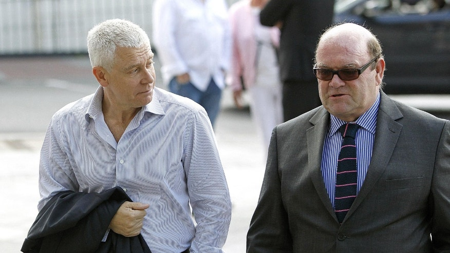 U2 bass guitarist Adam Clayton (left) arrive swith U2 manager Paul McGuinness  at Dublin Circuit Criminal Court, where his former personal assistant, Carol Hawkins, is on trial for more then 184 counts relating to the alleged embezzlement of 2.8 million euro ($3.56 million) of his funds Wednesday June 20, 2012. (AP Photo/Julien Behal/PA) UNITED KINGDOM OUT  NO SALES  NO ARCHIVE