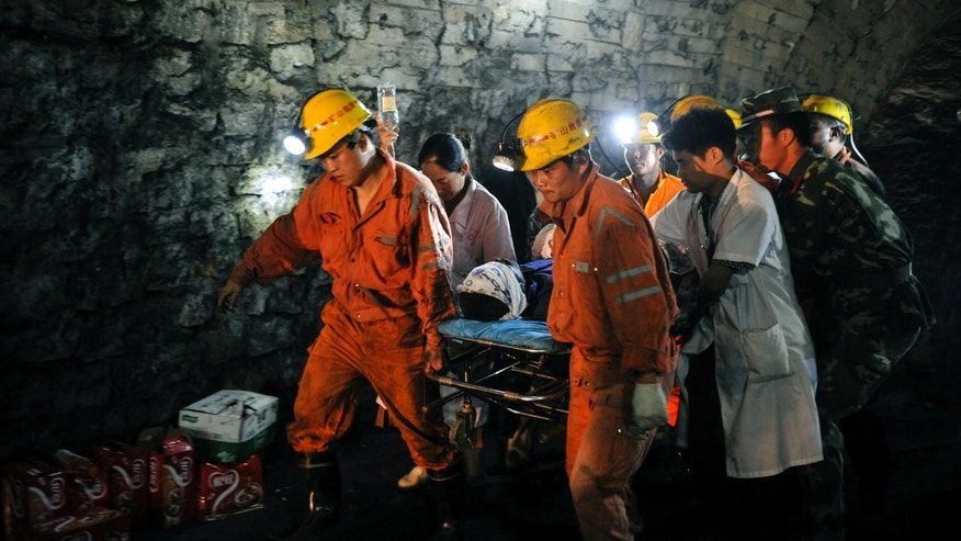 July 8, 2012: Liu Yunqing, the first miner rescued, is carried out on a stretcher from the flooded pit of Qielichong colliery in Sandu Township of Leiyang City, central China's Hunan Province.