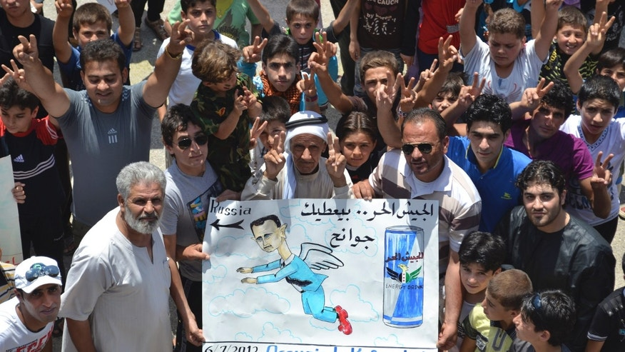 """July 6, 2012: This citizen journalism image released by Shaam News Network taken purports to show anti-Assad demonstrators in what they called a """"Friday of freedom from war"""" protest in Kafr Nabil, in Northwestern Syria."""