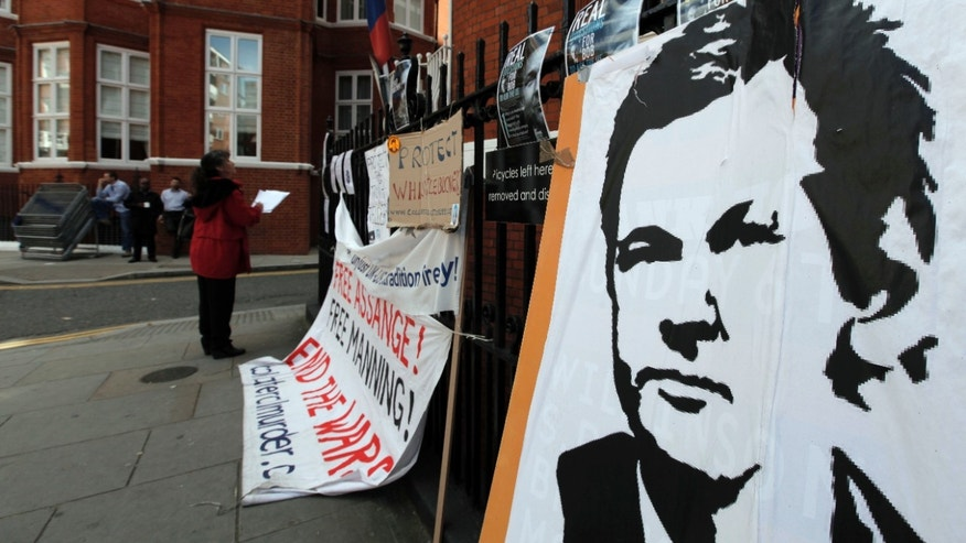 Placards and messages placed by supporters of WikiLeaks founder Julian Assange, are seen outside the Ecuador Embassy, London, Friday, June 29, 2012. Assange had entered the embassy in an attempt to gain political asylum to prevent him from being extradited to Sweden to face allegations of sex crimes, which he denies. (AP Photo/Lefteris Pitarakis)