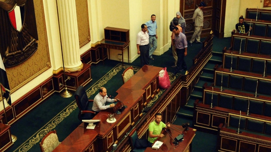 July 9, 2012:Officials are seen in the Egyptian parliament in Cairo.