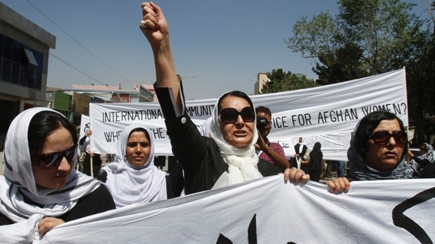 July 11, 2012: An Afghan protestor shouts slogans during a demonstration in support of female victims of abuse and violence in Kabul, Afghanistan.
