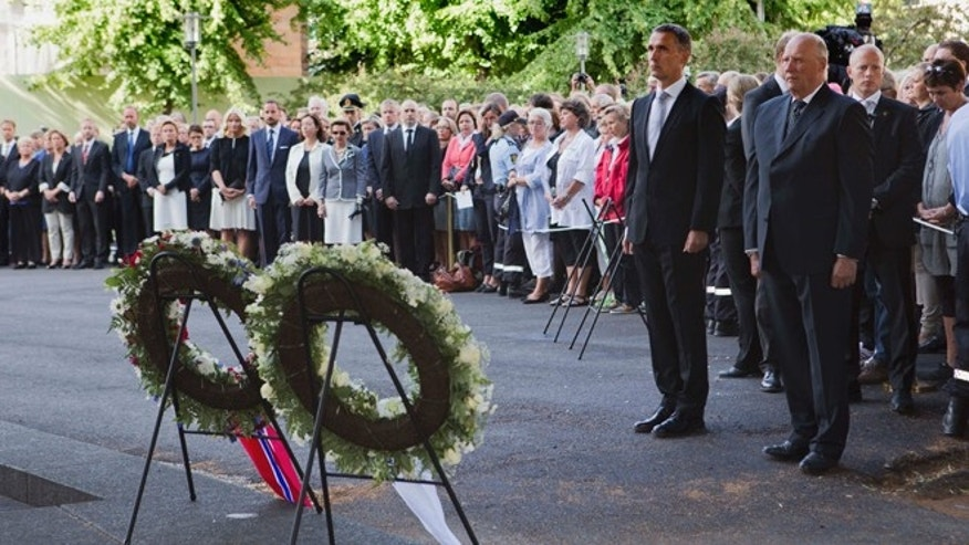 July 22, 2012: Norwegian King Harald, right, and Norwegian Prime Minister Jens Stoltenberg stand together during a wreath laying ceremony to mark the first anniversary of the bomb and shooting tragedy in Oslo and on the Utoeya Island, near the heavily damaged government office building in Oslo.