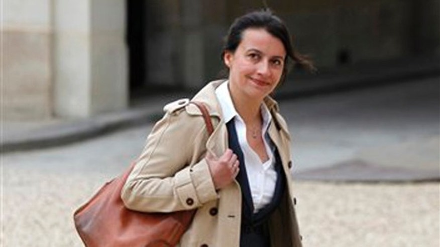 May 17, 2012: In this file photo newly named Housing Minister Cecile Duflot, wearing denim trousers, arrives for the first weekly cabinet meeting with new President Francois Hollande, at the Elysee Palace in Paris.