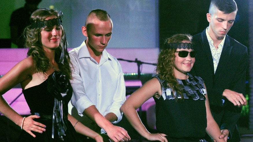 July 25, 2012: Two blind models present outfits during a fashion show for disabled women in Kiev, Ukraine.