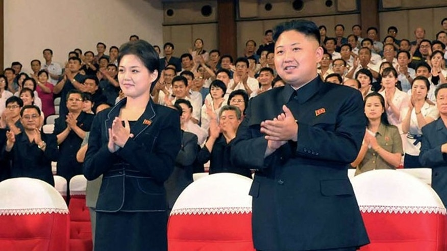 July 6, 2012:  North Korean leader Kim Jong Un, center right, and wife Ri Sol-ju clap.