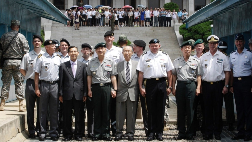 U.S. Gen. James D. Thurman, the commander of U.S. Forces Korea, fourth from right, poses with Neutral Nations Supervisory Commission, United Nations Forces and South Korean officers after a ceremony marking the 59th anniversary of the signing of the armistice agreement that ended the Korean War on July 27, 1953, at the border villages of Panmunjom, South Korea, Friday, July 27, 2012. (AP Photo/Ahn Young-joon. Pool)