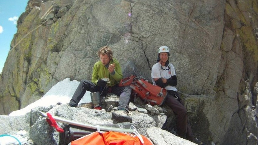 July 2012-- climber Gil Weiss, left, and Ben Horne pose for a photo as they climb the Palcaraju Peak in Peru.
