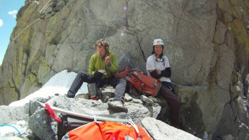 In this July 2012 photo provided by Galit Weiss, climber Gil Weiss, 29, left, and Ben Horne, 32, pose for a photo as they climb the Palcaraju Peak in Peru. Rescue coordinator Ted Alexander says a three-man team found the bodies of Weiss and Horne on Palcaraju in the Cordillera Blanca range on Saturday, July 28, 2012. (AP Photo/Courtesy of Galit Weiss)