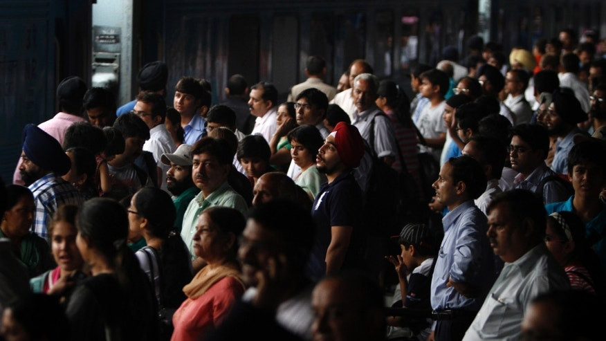 July 30, 2012: Stranded passengers wait for their power to get restore, at New Delhi railway station, in New Delhi, India.