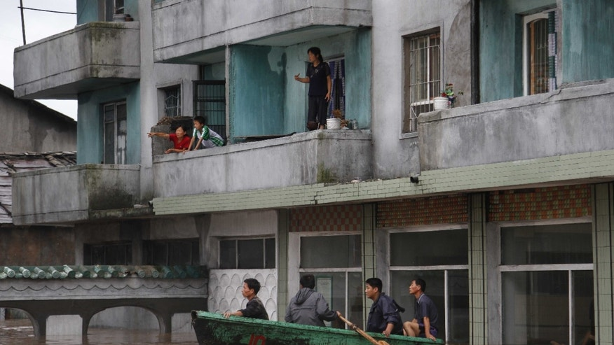 July 30, 2012 - Residents wait on the balcony of a flooded building in Anju City, South Phyongan Province, North Korea.