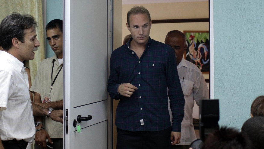 Swedish Jens Aron Modig arrives at a press conference in Havana, Cuba, Monday, July 30, 2012. (AP Photo/Franklin Reyes)