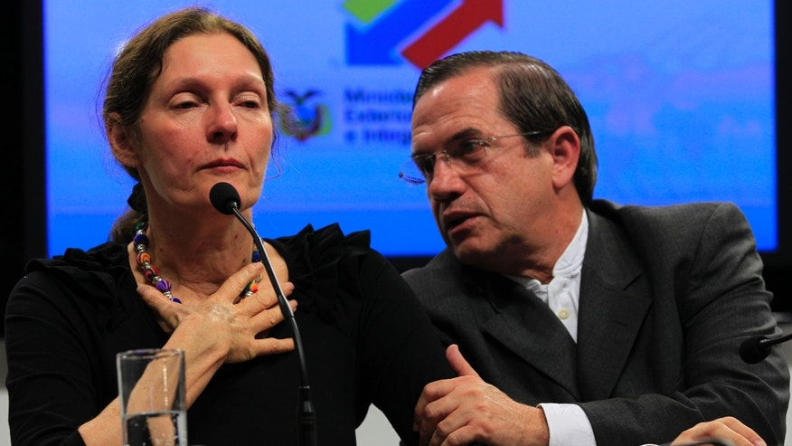 The mother of WikiLeaks founder Julian Assange, Christine Assange, is comforted by Ecuador's Foreign Minister Ricardo Patino during a press conference in Quito, Ecuador.