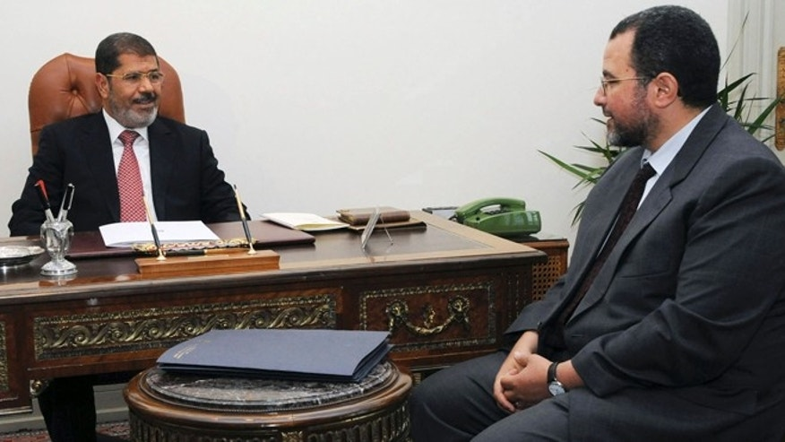FILE - In this Sunday, July 22, 2012 file photo released by the Egyptian Presidency, Egyptian President, Mohammed Morsi, left, meets with the minister of Water Resources and Irrigation, Hesham Kandil, at the Presidential Palace in Cairo.