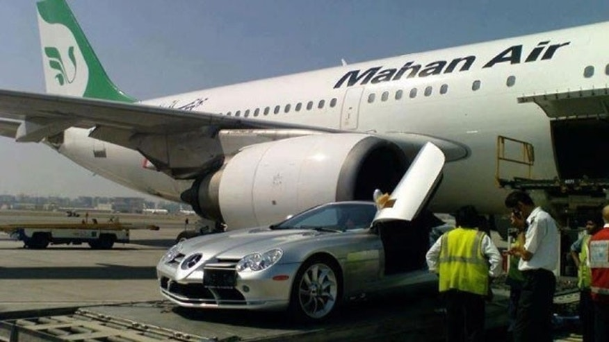 A Mercedes is loaded onto an Iranian plane.
